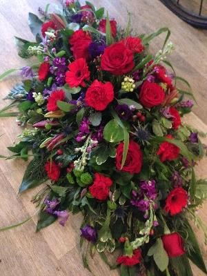 Red, blues and purple casket spray