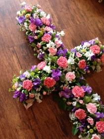 Casket cross in pinks and mauves